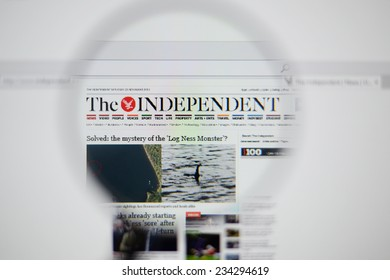 LISBON, PORTUGAL - NOVEMBER 30, 2014: Photo of The Independent homepage on a monitor screen through a magnifying glass.