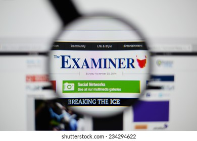 LISBON, PORTUGAL - NOVEMBER 30, 2014: Photo of The Examiner homepage on a monitor screen through a magnifying glass.