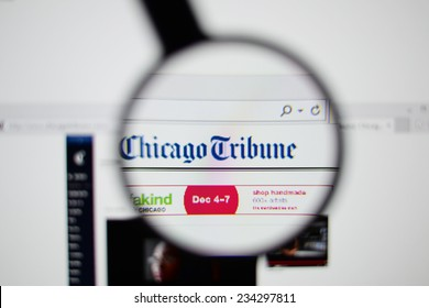 LISBON, PORTUGAL - NOVEMBER 30, 2014: Photo of The Chicago Tribune homepage on a monitor screen through a magnifying glass.