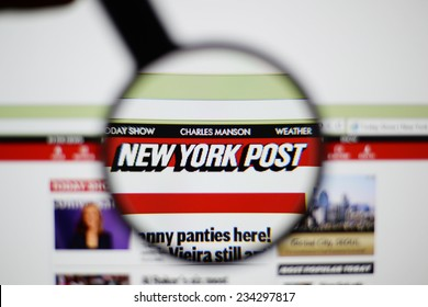 LISBON, PORTUGAL - NOVEMBER 30, 2014: Photo of New York Post homepage on a monitor screen through a magnifying glass.