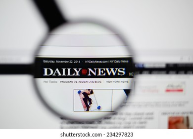 LISBON, PORTUGAL - NOVEMBER 30, 2014: Photo of The Daily News homepage on a monitor screen through a magnifying glass.