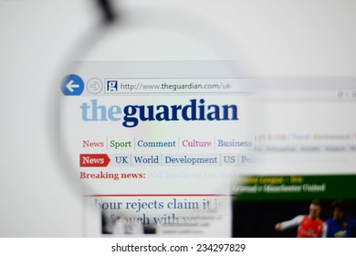 LISBON, PORTUGAL - NOVEMBER 30, 2014: Photo of The Guardian homepage on a monitor screen through a magnifying glass.