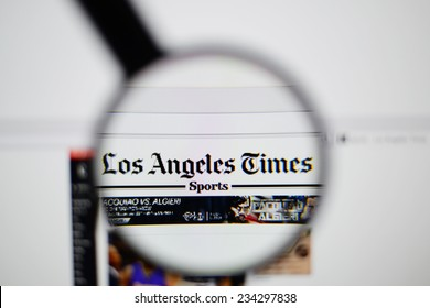 LISBON, PORTUGAL - NOVEMBER 30, 2014: Photo of The Los Angeles Times homepage on a monitor screen through a magnifying glass.