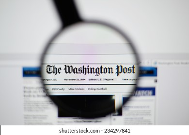 LISBON, PORTUGAL - NOVEMBER 30, 2014: Photo of The Washington Post homepage on a monitor screen through a magnifying glass.