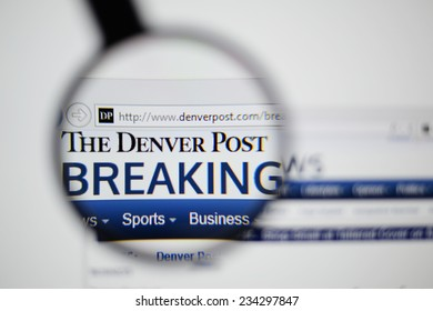 LISBON, PORTUGAL - NOVEMBER 30, 2014: Photo of The Denver Post homepage on a monitor screen through a magnifying glass.