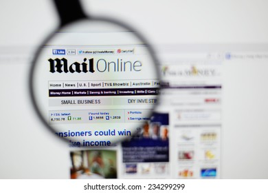 LISBON, PORTUGAL - NOVEMBER 30, 2014: Photo of the Mail Online homepage on a monitor screen through a magnifying glass.