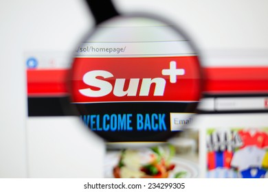 LISBON, PORTUGAL - NOVEMBER 30, 2014: Photo of the Sun homepage on a monitor screen through a magnifying glass.