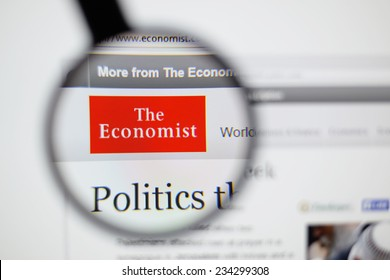 LISBON, PORTUGAL - NOVEMBER 30, 2014: Photo of The Economist homepage on a monitor screen through a magnifying glass.