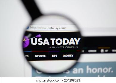 LISBON, PORTUGAL - NOVEMBER 30, 2014: Photo of the USA Today homepage on a monitor screen through a magnifying glass.
