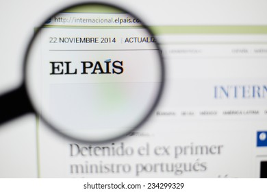 LISBON, PORTUGAL - NOVEMBER 30, 2014: Photo of El Pais homepage on a monitor screen through a magnifying glass.