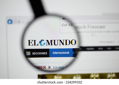 LISBON, PORTUGAL - NOVEMBER 30, 2014: Photo of El Mundo homepage on a monitor screen through a magnifying glass.
