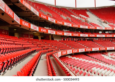 LISBON, PORTUGAL - OCT 17, 2016: Red seats of the Estadio da Luz (Stadium of Light), home stadium for the S.L. Benfica. It was built for the EURO 2004
