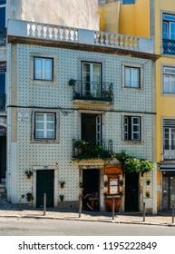 Lisbon, Portugal - Oct 3, 2018: Typical facade of restaurant in Bairro Alto bohemian neighbourhood of Lisbon, Portugal