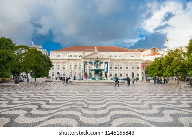 LISBON, PORTUGAL - OCT 30, 2018: Tourists in the popular Rossio Square (also known as Pedro IV Square or Praça de D. Pedro IV)  in Lisboa, Portugal .