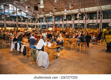 LISBON, PORTUGAL - OCT 30, 2018, 2018: People eat at TimeOut Market in Lisbon, Portugal. TimeOut Market is a unique attempt to bring all best restaurants in Lisbon at one place.