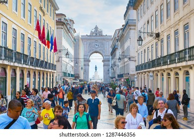 LISBON, PORTUGAL - OCTOBER 10, 2018: People on Augusta street in the day. Augusta Street with the Triumphal Arch - is the famous tourist attraction in Lisbon