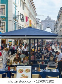 LISBON, PORTUGAL - OCTOBER 10, 2018: People on Augusta street in the day. Augusta Street with the Triumphal Arch - is the famous tourist attraction in Lisbon.