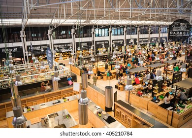 Lisbon, Portugal - October 19, 2015: Food Market Mercado da Ribeira in Lisbon is a major tourist attraction, longer exposure to show some movement of the people.