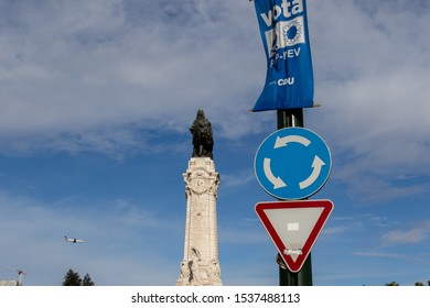 Lisbon, Portugal - October 20, 2019: Monument to Sebastiao Jose de Carvalho e Melo on the Marquis of Pombal Square and traffic signs