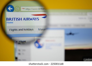 LISBON, PORTUGAL - OCTOBER 21, 2014: Photo of British Airways homepage on a monitor screen through a magnifying glass.
