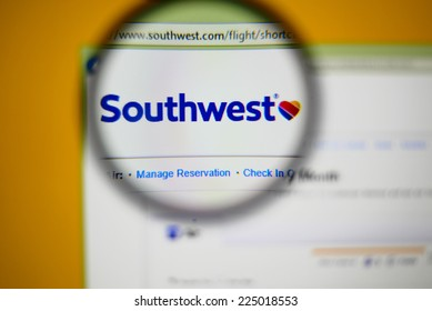 LISBON, PORTUGAL - OCTOBER 21, 2014: Photo of Southwest Airlines homepage on a monitor screen through a magnifying glass.
