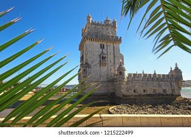 Lisbon, Portugal - October 27, 2018: People stay in queue to visit Belem Tower (Torre de Belem), fortified complex in civil parish of Santa Maria de Belem on bank of river Tejo. Symbol of Portugal.