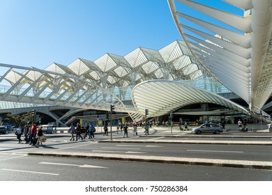 Lisbon, PORTUGAL, October 30, 2017: People crossing the street on a Gare do Oriente (Lisbon Oriente Station), large Portuguese intermodal transport hubs situated in the Park of the Nations.