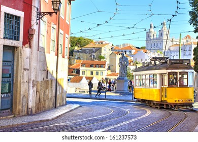 LISBON, PORTUGAL - OCTOBER 30 : Vintage yellow tramway in the city center if Lisbon - one of the main tourist attractions on October 30th 2013 in Lisbon, Portugal