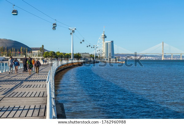 LISBON, PORTUGAL - OCTOBER 4, 2019: Cable cars on the Tagus river at Parque das Nacoes (Park of Nations) in Lisbon, Portugal