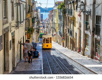 LISBON, PORTUGAL - OCTOBER 9, 2018:  Lisbon's Gloria funicular classified as a national monument opened 1885 located on the west side of the Avenida da Liberdade connects downtown with Bairro Alto.