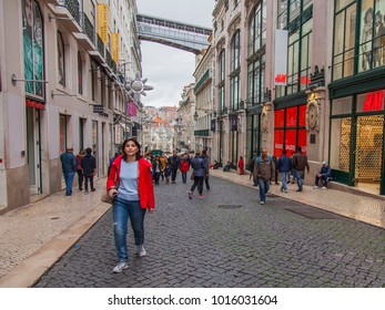 LISBON, PORTUGAL, on January 5, 2018. People go along the picturesque street in downtown in cloudy weather