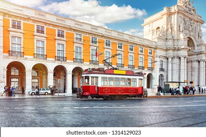Lisbon, Portugal. Red touristic tram at Praca do Comercio (Commercial Square) near Triumphal Arch of Rua Augusta. Sunny day in famous tourist place of Lisboa.