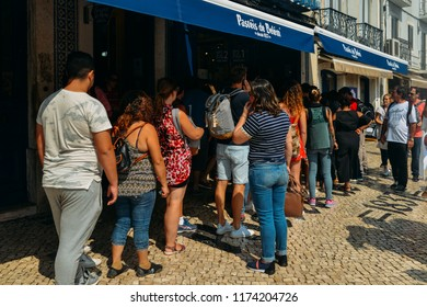 Lisbon, Portugal - Sept 7, 2018: People queue in front of Pasteis de Belem bakery in Lisbon, Portugal which is the birthplace of this famous portuguese pastry dessert called Pasteis de Nata