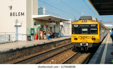 Lisbon, Portugal - Sept 7, 2018: Train at Belem station on the Cascais Line travelling parallel to the India Avenue in Belem, Lisbon, Portugal