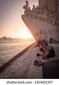 LISBON, PORTUGAL - SEPTEMBER 10, 2019: locals and tourists appreciating the sunset at Padrao Dos Descobrimentos in Lisbon, Portugal by the Tejo River.