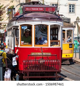 LISBON, PORTUGAL - SEPTEMBER 10, 2019: The historic architecture of Lisbon in Portugal with its iconic Tram28 trolley travelling across the Alfama neighborhood on a sunny day.