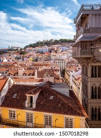 LISBON, PORTUGAL - SEPTEMBER 10, 2019: The historic architecture of Portugal as seen from the Cidade Alta neighborhood with the famous Elevador de Santa Justa Lift on the right side.