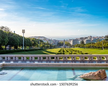 LISBON, PORTUGAL - SEPTEMBER 10, 2019: the historic architecture of Lisbon in Portugal showcasing the Parque Eduardo VI Park in the foreground and the Marques de Pombal Square at the background.