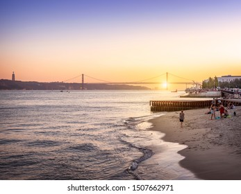 LISBON, PORTUGAL - SEPTEMBER 10, 2019: View of Lisbon in Portugal at sunset showcasing the Tejo River and the 25 de Abril bridge at the background.