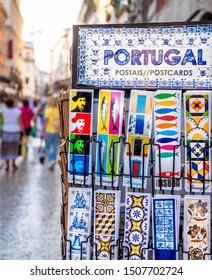 LISBON, PORTUGAL - SEPTEMBER 10, 2019: The historic city of Lisbon in Portugal showcasing local art and craft with the Rua do Commercio street at the background.