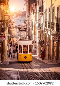 LISBON, PORTUGAL - SEPTEMBER 10, 2019: The traditional Portuguese Funicular going up the steep hills of Lisbon in Portugal taking tons of tourists to see the amazing architecture of the city.