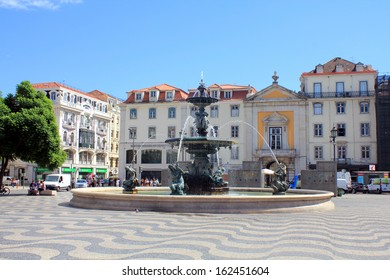 LISBON, PORTUGAL - SEPTEMBER 10: Rossio Square on September 10, 2013 in Lisbon Portugal. Rossio Square is one of main tourist destinations of Lisbon city.