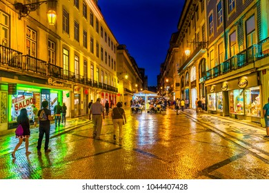 LISBON, PORTUGAL - SEPTEMBER 11, 2017 Rua Augusta Street Evening Walking Shopping Street Black White Tiles Shops Restaurants Baixa Lisbon Portugal.  Rua Augusta is main walking street in Lisbon.
