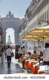 Lisbon, Portugal - September 20, 2014: Pavement cafes and shops in Rua Augusta, downtown Lisbon