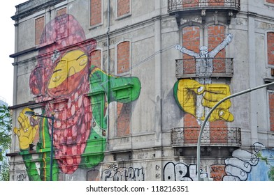 LISBON, PORTUGAL - SEPTEMBER 24: Street art by Os Gemeos..Lisbon, September 24, 2012. The graffiti was created in May of 2010, under the Cronos project initiative, in partnership with the Lisbon city.