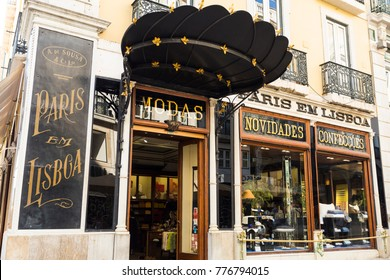 LISBON, PORTUGAL – September 25, 2017: Front windows of the centenary Fashion Shop in Chiado old quarter of Lisbon, Portugal Translation: PARIS IN LISBON