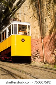 LISBON, PORTUGAL - SEPTEMBER 29,2017. Typical view of the colorful streets with famous yellow tourist tram in Lisbon, Portugal.