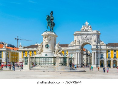 LISBON, PORTUGAL, SEPTEMBER 3, 2016: People are passing through praca do comercio in Lisbon, Portugal.