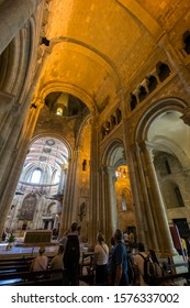 Lisbon, Portugal - September 7, 2019: Tourists at the Lisbon Cathedral (Patriarchal Cathedral of St. Mary Major), also known as Se, in Lisbon, Portugal.