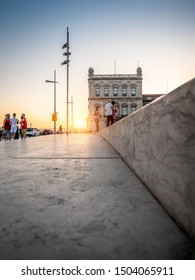 LISBON, PORTUGAL - SEPTEMBER 8, 2018: view of the historic city of Lisbon in Portugal showcasing a piece of the Comercio Square at sunset.